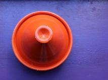 Orange tajine on purple background