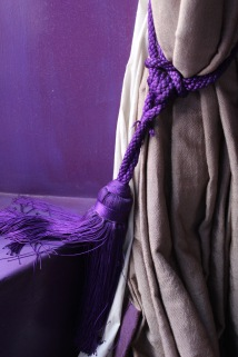 Bright curtains with purple tassel